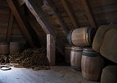picture of acadian  - louisbourg interior of a historic building with storage barrels and rope - JPG
