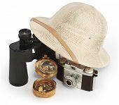 picture of safari hat  - safari pith helmet leaning against binoculars isolated on white background with brass compass and vintage view camera - JPG