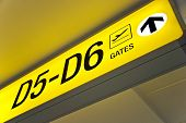 Detailed view of yellow airport departure sign