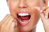 Постер, плакат: Woman teeth with dental floss Dentistry health care