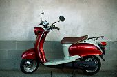 stock photo of vespa  - an old scooter parked along the street - JPG