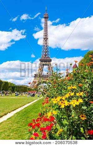poster of The Eiffel Tower and colorful flowers at the Champ de Mars on a beautiful summer day in Paris
