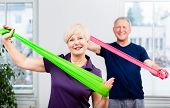 Older patients in physiotherapy using power band for strength training poster