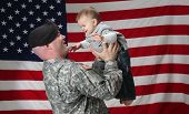 stock photo of soldier  - An American soldier holds his infant son - JPG