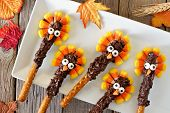 Thanksgiving Candy Corn Turkey Pretzel Rods On A White Plate, Overhead Scene poster