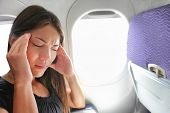 Travel plane sick woman. Fear of flying girl in airplane airsick with stress headache and motion sic poster