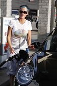 MALIBU - FEB 4: Katie Price fills up her car with gas and gets a few soft drinks for her friends on
