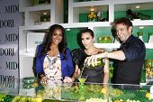 WEST HOLLYWOOD, CA - MAY 10: LaLa Vasquez, Kim Kardashian, Scott Ford at the Midori Melon Liqueur Trunk Show at Trousdale on May 10, 2011 in West Hollywood, California