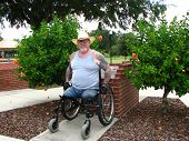image of amputee  - A disabled Vietnam Vet taking it easy in the park on a nice day - JPG