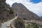 Tourist Exploring The Inca Trails And The Archaeological Site At Ollantaytambo, Sacred Valley, Trave poster