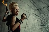 picture of brass knuckles  - Punk girl behind broken glass - JPG