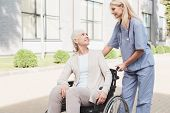 Nurse And Senior Woman In Wheelchair poster