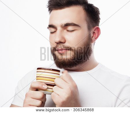 poster of Good morning, man holding a cup tea. Morning concept.