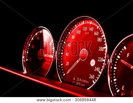 poster of Close Up Shot Of A Red Speedometer In A Car. Car Dashboard. Dashboard Details With Indication Lamps.