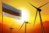 Estonia Wind Energy, Alternative Energy Environment Concept With Turbines And Flag On Sunset - Alter poster