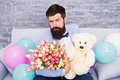 How Successfully Ask Her Dating. Romantic Man With Flowers And Teddy Bear Sit On Couch Waiting Girlf poster