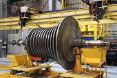 Steam turbine being worked on in an industrial manufacturing factory