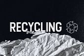 Black Textured Carton Background With Printed White Recycling Logo Sign And Piece Of Recycled Crumpl poster