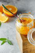Homemade Orange Jam In Glass Jar On The Wooden Box On The Gray Background. Orange Jam In Swing-top J poster
