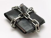 stock photo of save money  - Locked wallet with chain and padlock save money concept - JPG