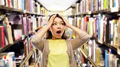 education, knowledge and stress concept - stressed asian woman holding to her head over book shelves poster