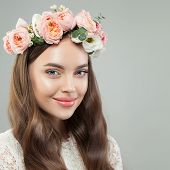 Pretty Smiling Woman With Clear Skin, Long Shiny Hair And Flowers. Beautiful Face Close Up poster