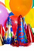 pic of party hats  - Birthday party background with party hats floating balloons and streamers - JPG