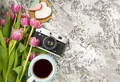 The Old Camera Is Lying On A Concrete Table, Next To A Cup With Hot Tea, Next To A Pink Cookie, Next poster