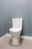 Simple, clean and white toilet in a bathroom