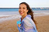 Happy Woman On The Beach. Portrait Of Beautiful Girl With Wind Fluttering Hair And Pareo. Summer Por poster