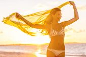 Happy Asian woman with healthy body wellness and wellbeing concept Bikini girl feeling free in wind  poster