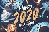 2020 Happy New Year Hand Brush Storke Font On Marble Table With Party Cup,party Blower,tinsel,confet poster