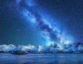 Bright Milky Way Over Snow Covered Mountains And Sea At Night In Winter In Norway. Landscape With Sn poster