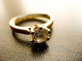 Gold Ring  Diamond Gem Closeup. Gold Wedding Or Engagement  Ring Decorated With Diamond poster