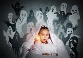 Surprised Girl With Flashlight Hiding Under Blanket. Amazed Kid Sitting In His Bed At Home. Fear Of  poster