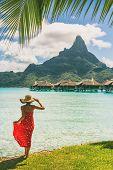 Tahiti resort travel honeymoon destination tourist woman walking on beach of private island at overw poster