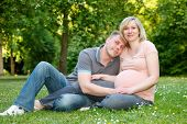 stock photo of pregnant woman  - Pregnant couple in the park - JPG