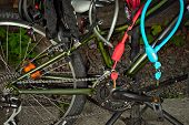 Many Different Colored Locks For A Bicycle. Coded Locks And Locks With Keys On The Background Of A B poster