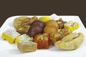 stock photo of halwa  - Mixed Indian Sweets on a White Plate - JPG