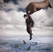 stock photo of loneliness  - Concept of failure of a businessmamn in an ocean - JPG