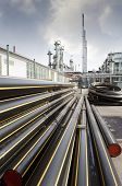 stock photo of refinery  - pipelines and tubes leading oil and fuel - JPG