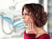 stock photo of molar tooth  - Girl with a painful tooth in a medical office - JPG