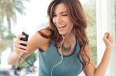Young Beautiful Woman Enjoying Music On Earphones