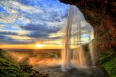 stock photo of waterfalls  - Seljalandfoss Waterfall At Sunset In Hdr - JPG