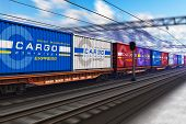stock photo of electric station  - Freight train with color cargo containers passing railway station in winter with motion blur effect - JPG