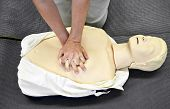 pic of cpr  - A man practicing CPR techniques on dummy - JPG