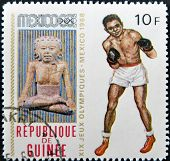 A stamp printed in Guinea-Bissau shows , series devoted Olympic games in Mexico, boxing