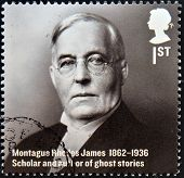 A stamp printed in Great Britain shows Montague Rhodes James Scholar and author of ghost stories