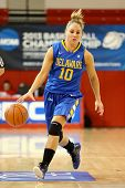 JAMAICA, NY-JAN 2: Delaware Blue Hens guard Kayla Miller (10) dribbles the ball against the St. John