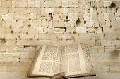 stock photo of israel people  - Excerpt from a Torah scroll the background kotel sacred to the Jewish people - JPG